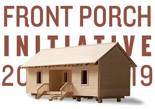 A wooden model of 20K Mac's Home in front of the text Front Porch Initiative 2019