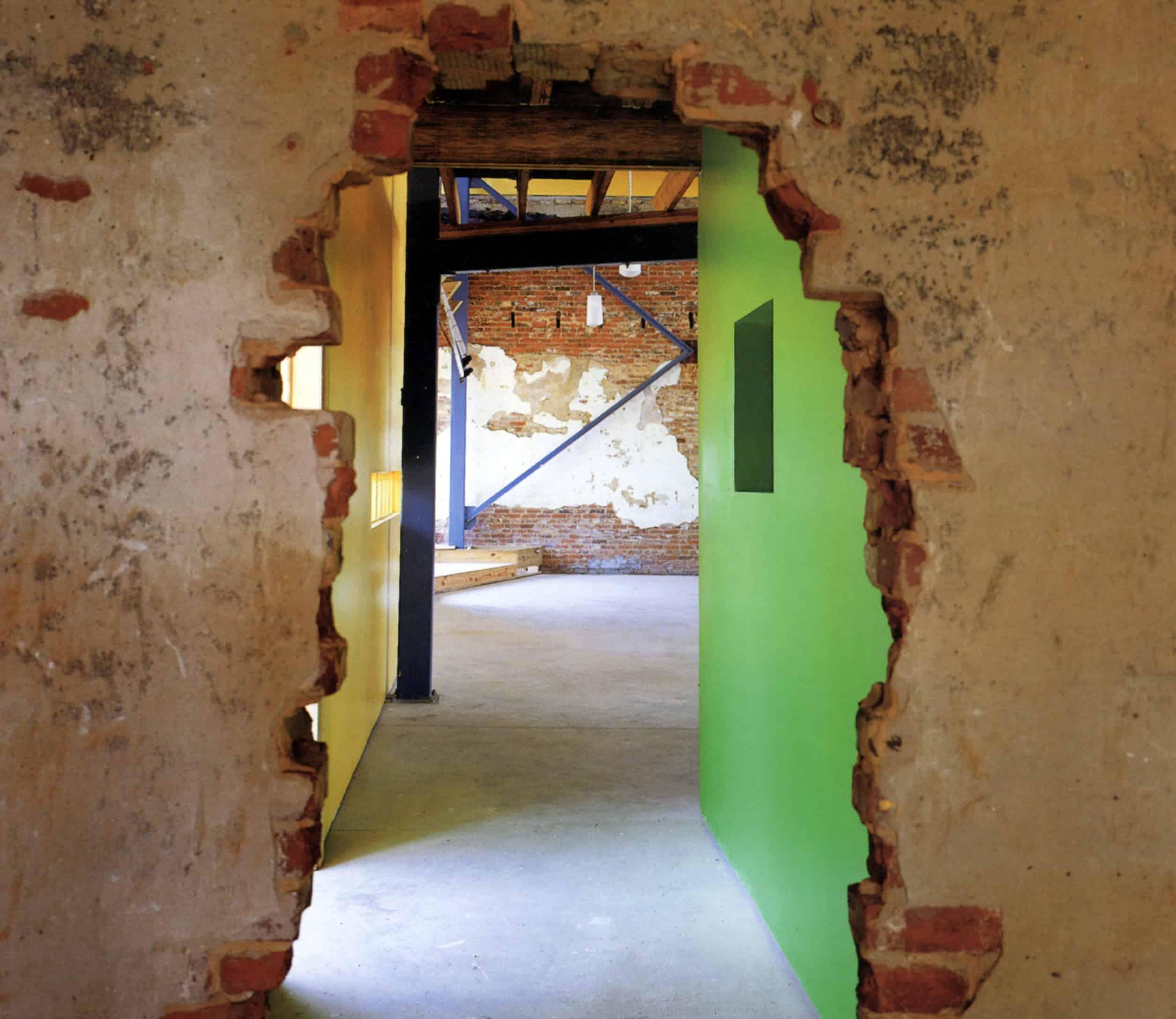 doorway with exposed brick