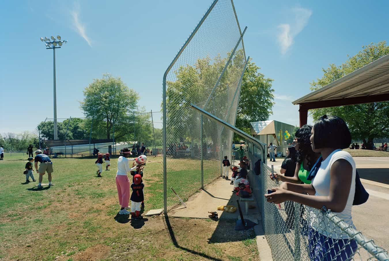 People enjoying a little league baseball game