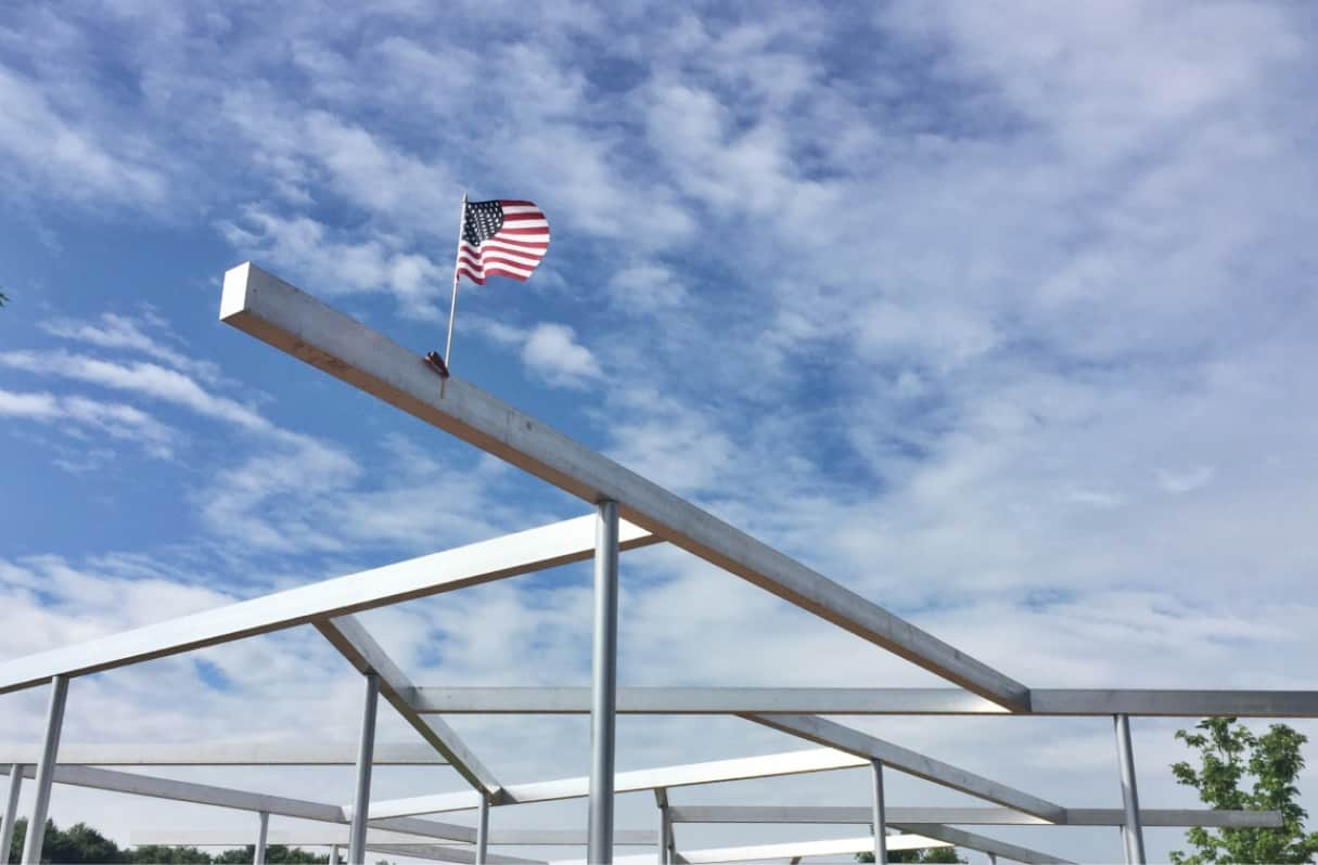 Lion's Park shade structure with an American flag flying on top