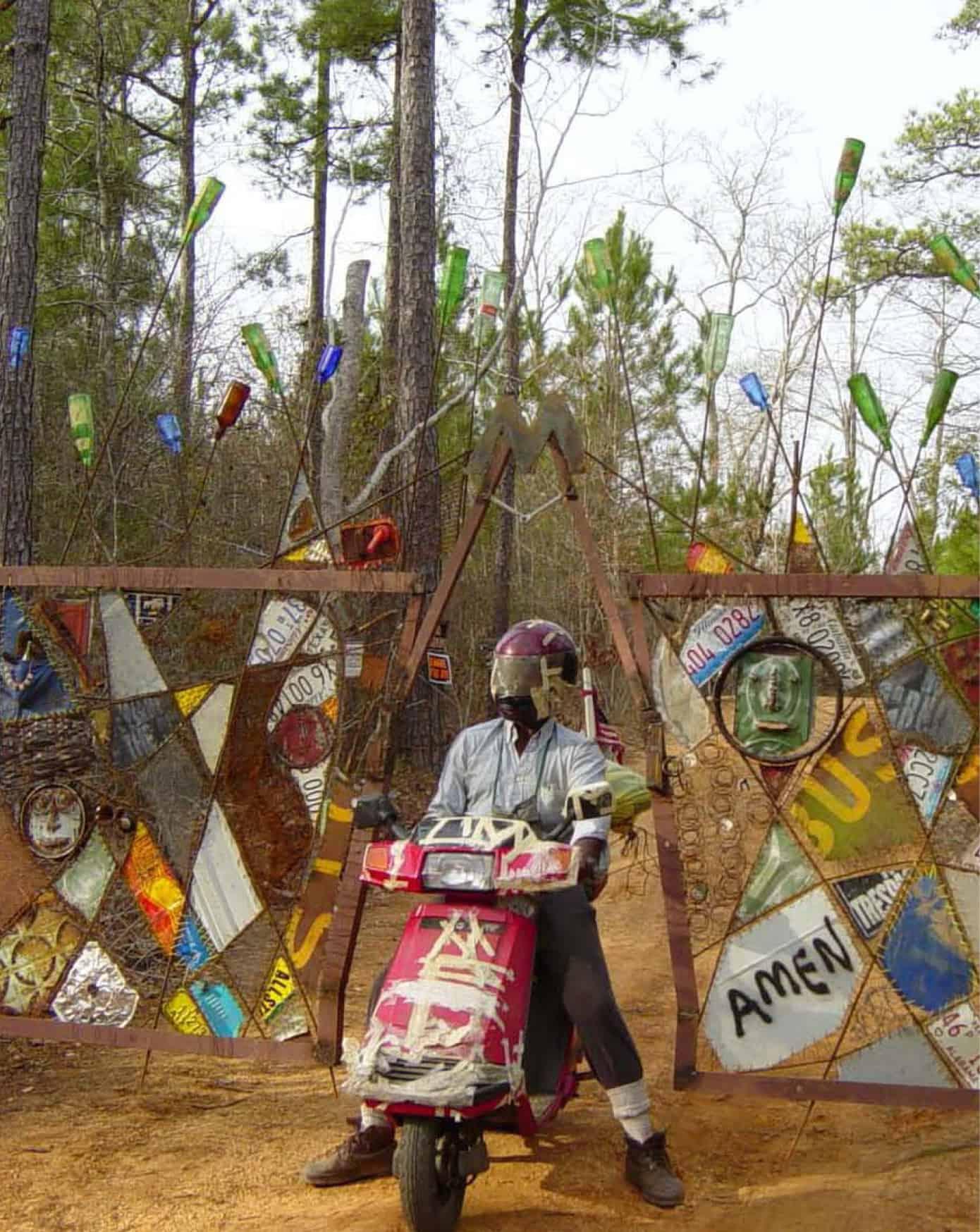 Music Man pulling through his custom gate in his motorcycle