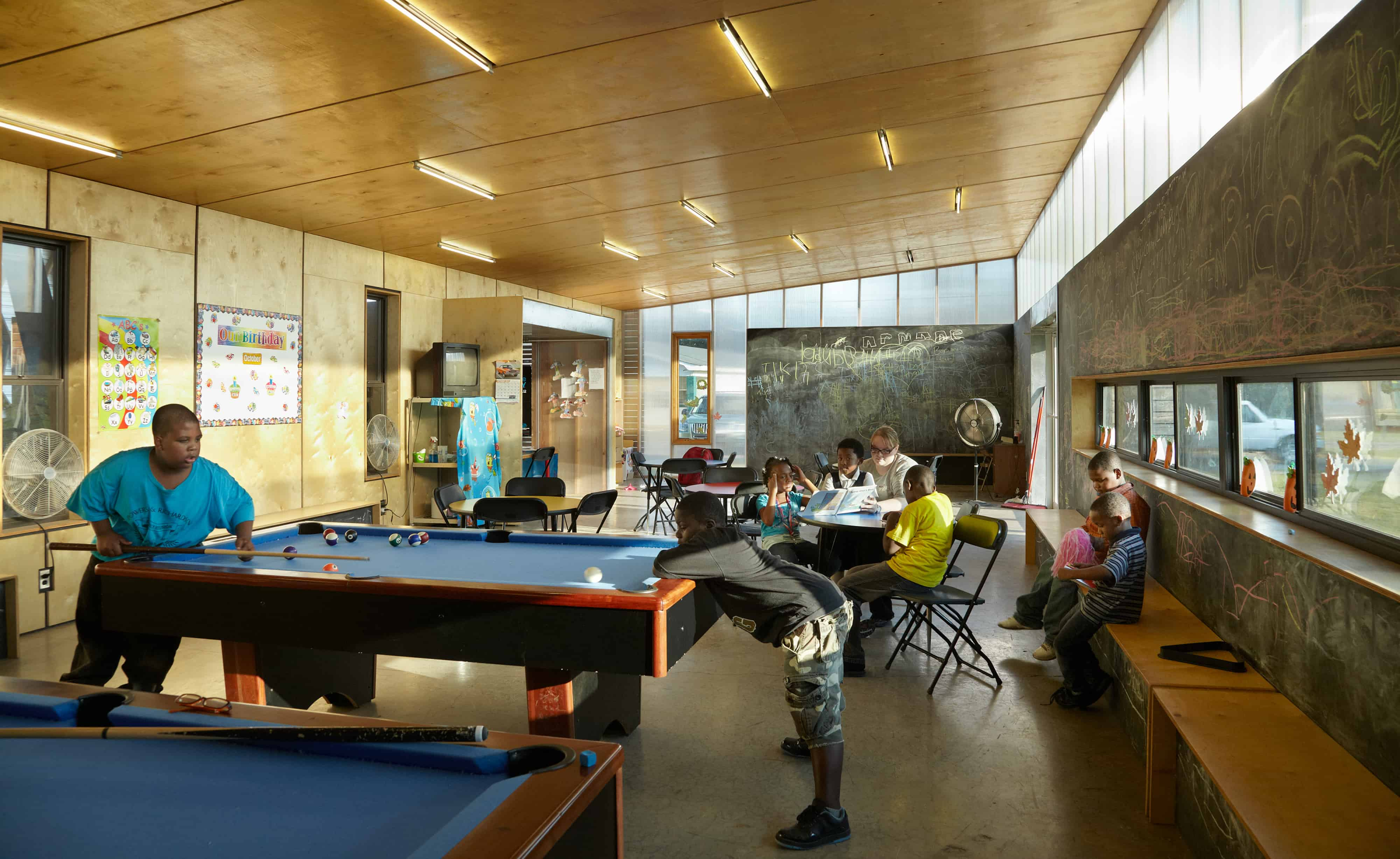 kids play pool inside the club