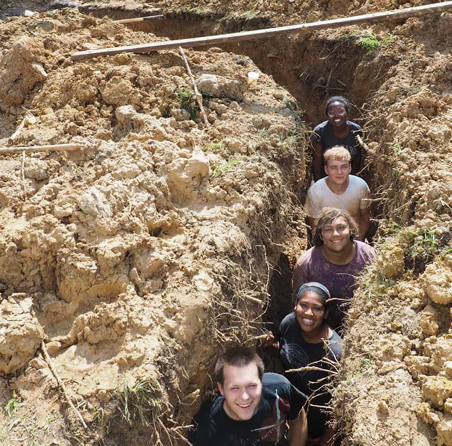 earth tube students in trench