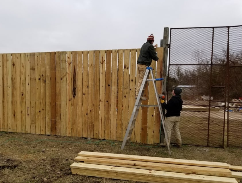 Students building fence