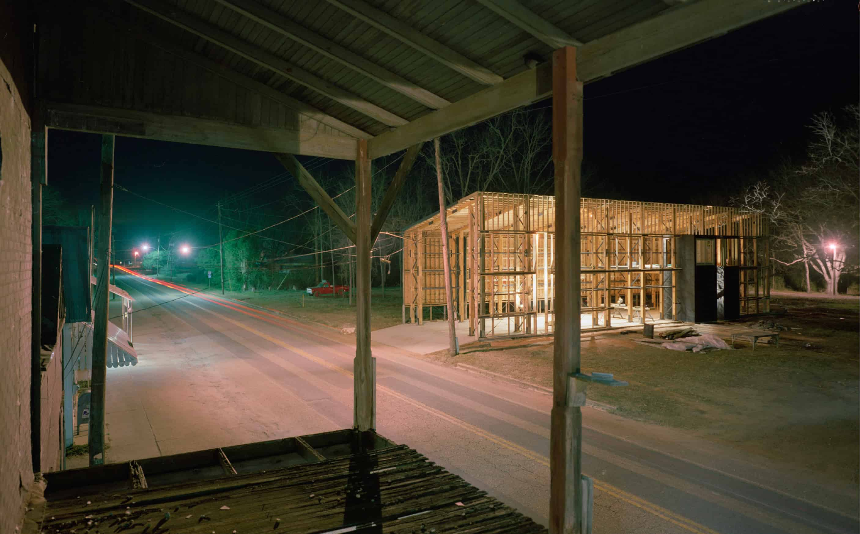 firehouse under construction at night, taken from landing of red barn