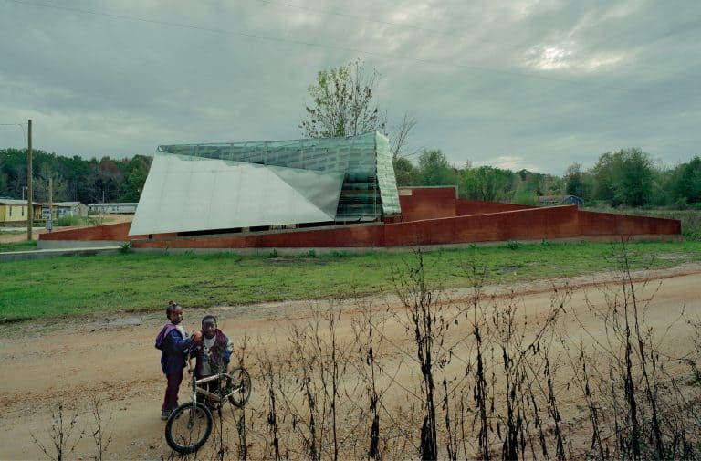 Two kids on bikes outside of the Glass Chapel