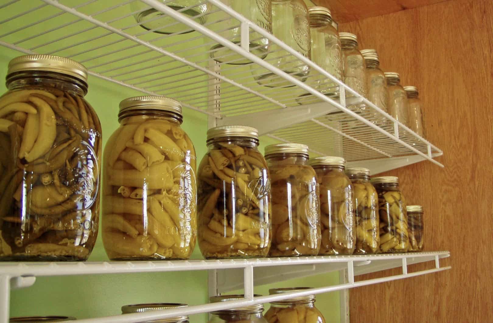 pickled vegetables in jars on shelf