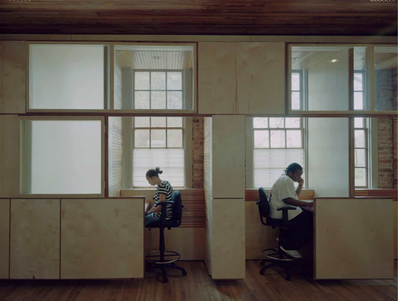 two students studying in carrels