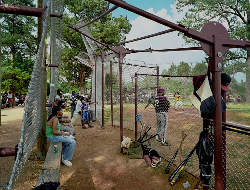 The dugout area of the baseball field, where players wait to bat