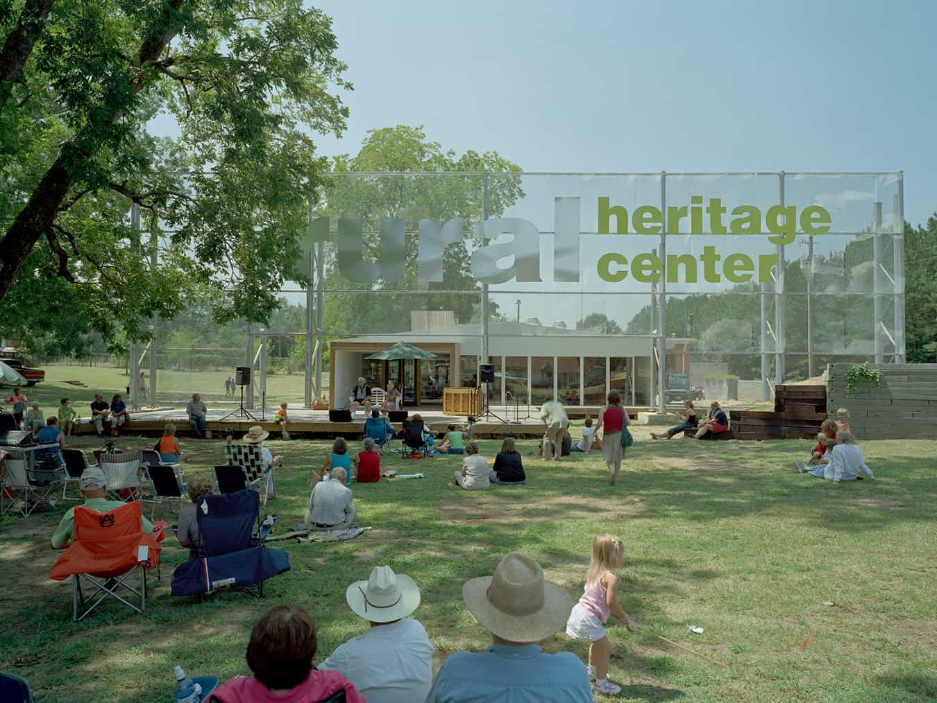People on the lawn of the Rural Heritage Center, enjoying a show