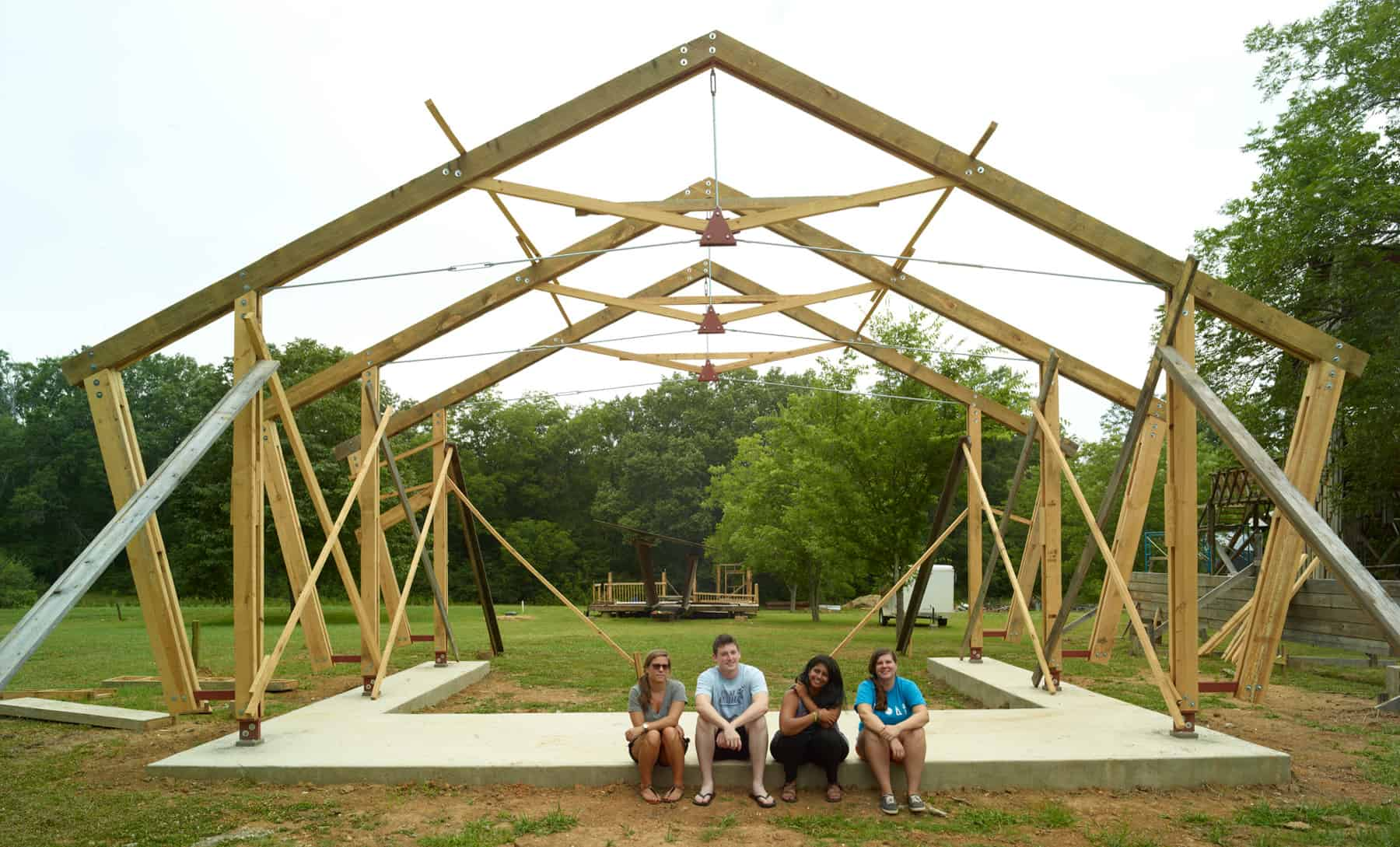 student team posing by partially constructed building