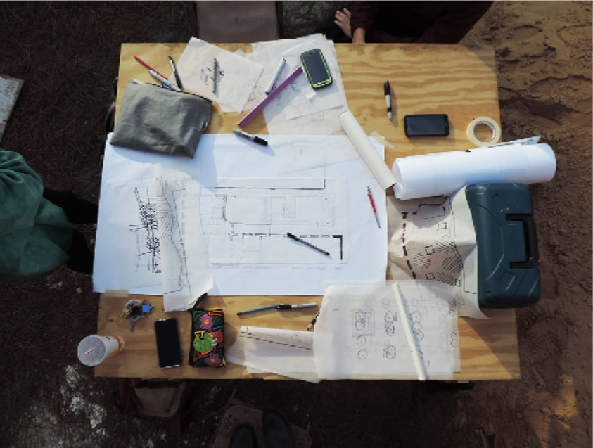 students desk covered with blueprints