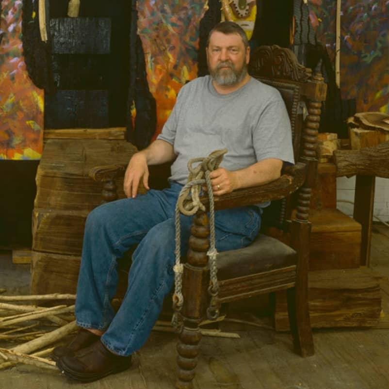 portrait of Sambo Mockbee in chair
