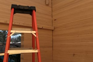 milled timber stacked wall corner view