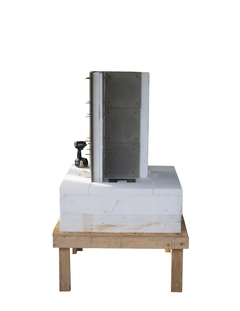 wooden base with foam and two concrete chimney panels