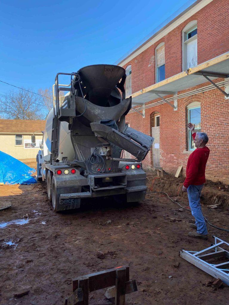 Andrew directing concrete truck
