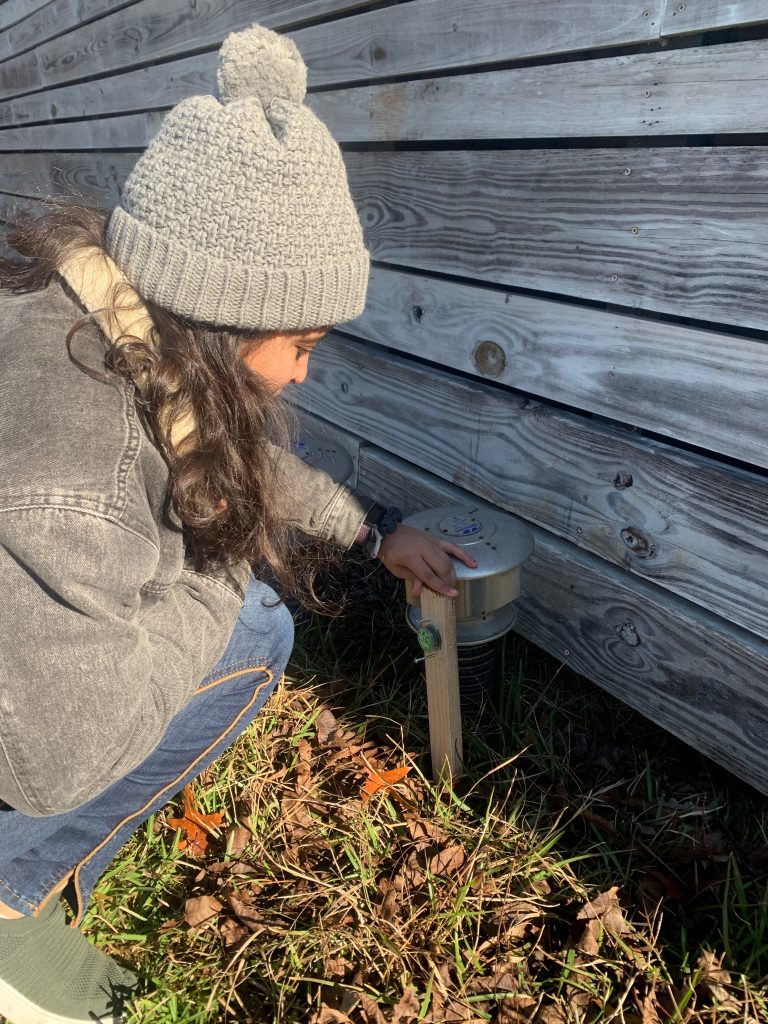 Marlyn installing temperature sensor near Earthtube intake