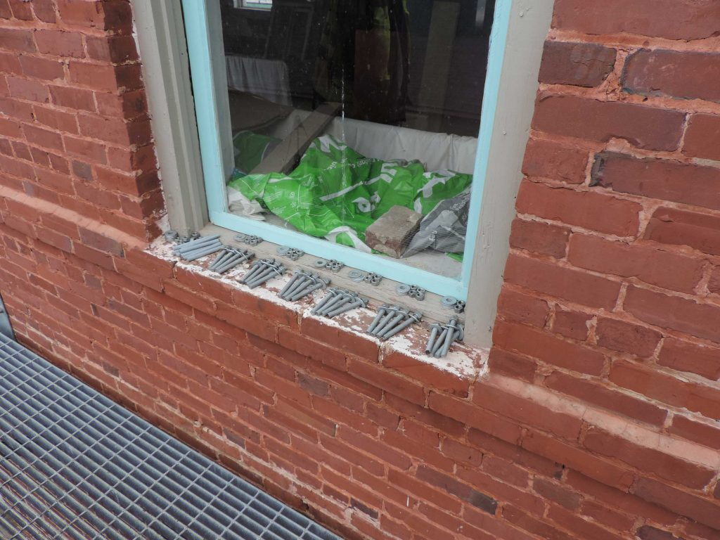 hardware sitting on window sill