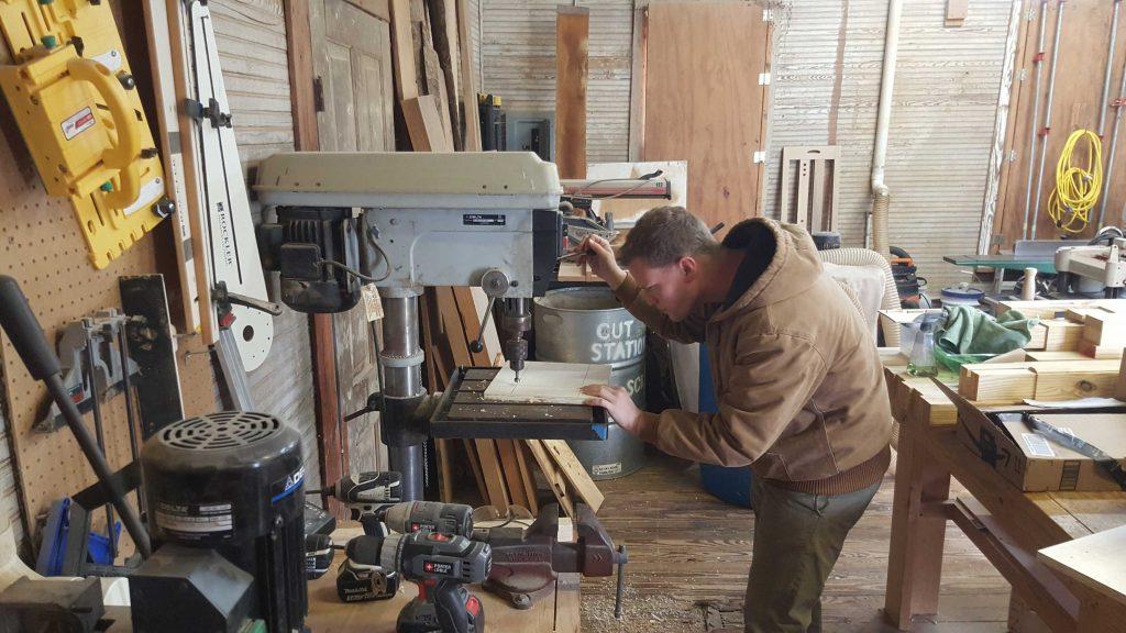 Zack using the drillpress