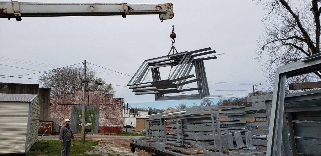 boom truck lifting eight foot screens