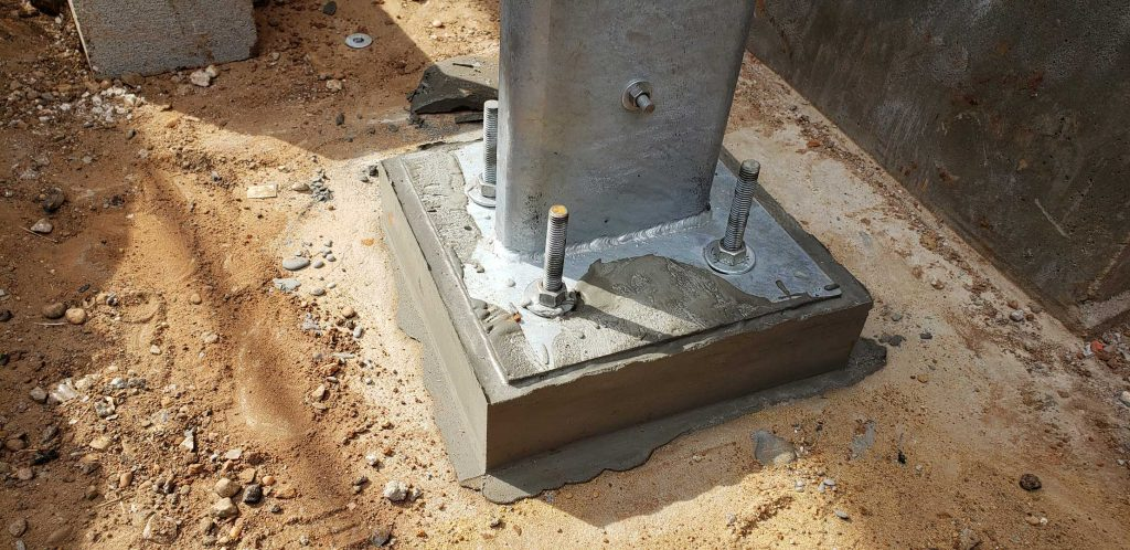 Grout under footing plate drying
