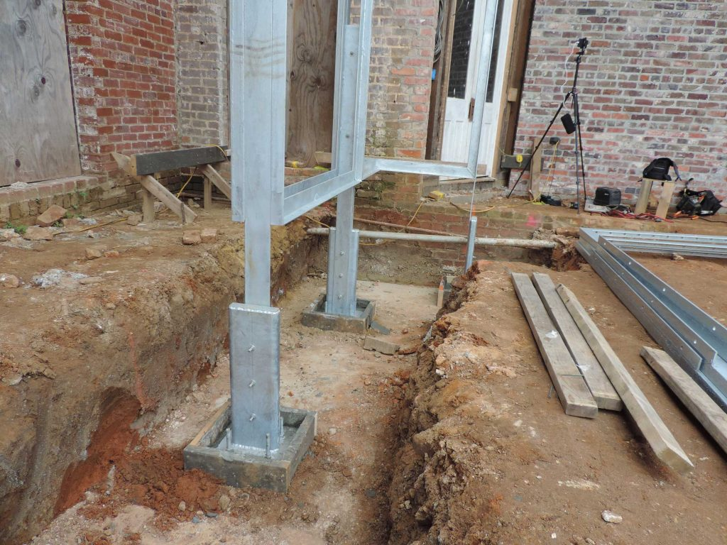 Grout formwork around footing plates