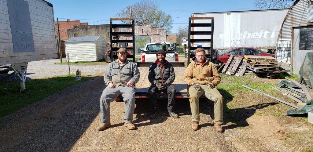 Mason, Caleb and Zack sitting on trailer