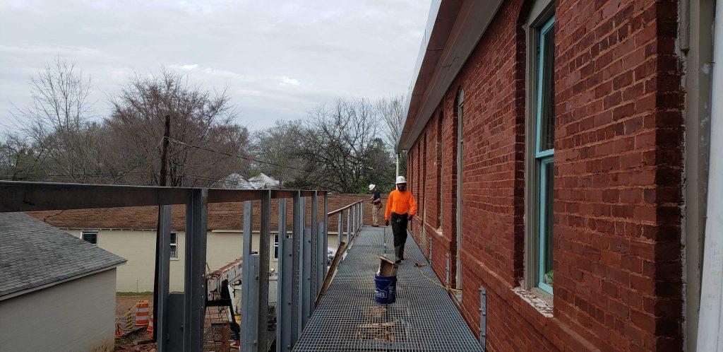 Caleb and Zack installing railings