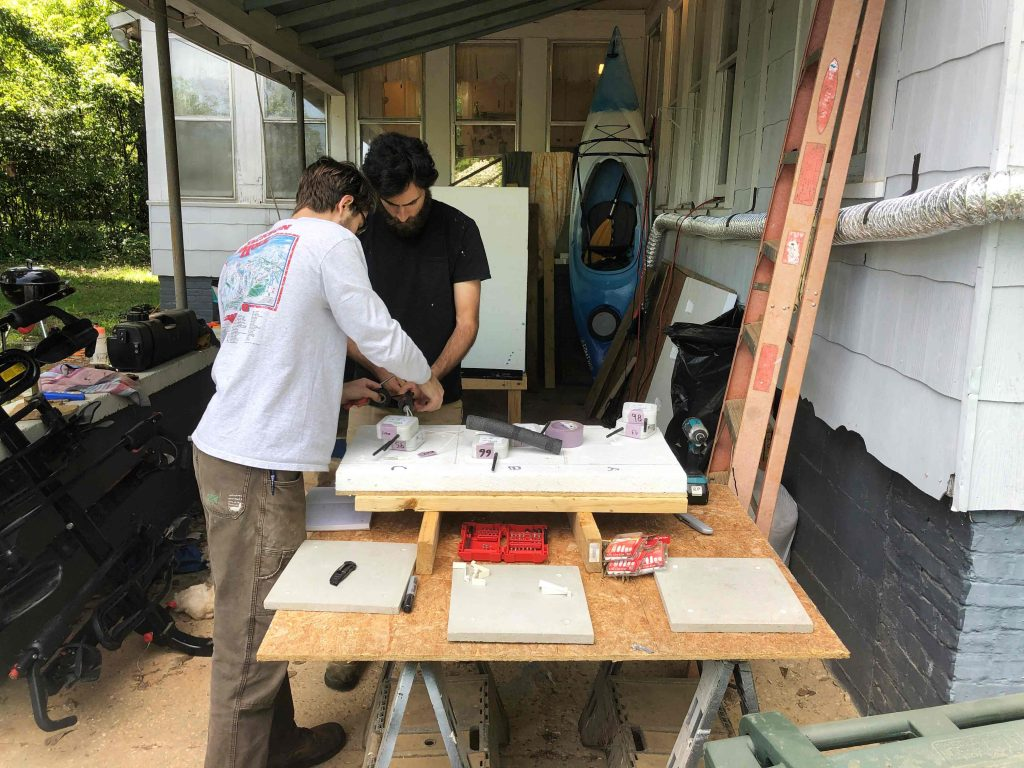 Cory and Rowe installing sensors