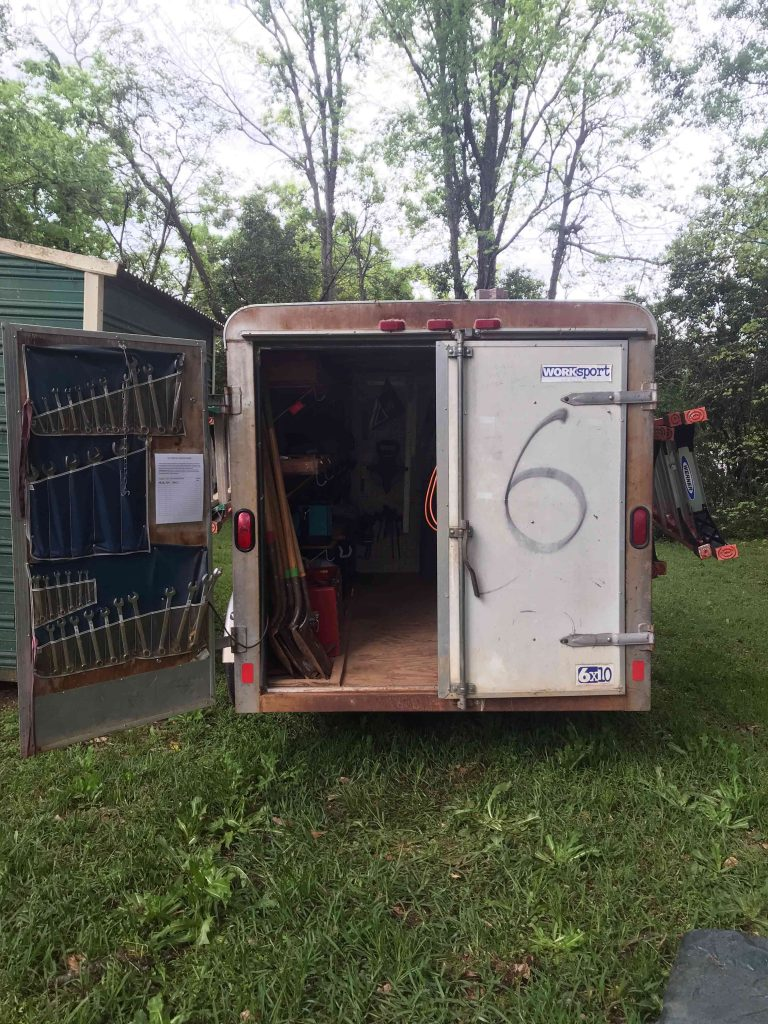 box trailer containing tools in a backyard