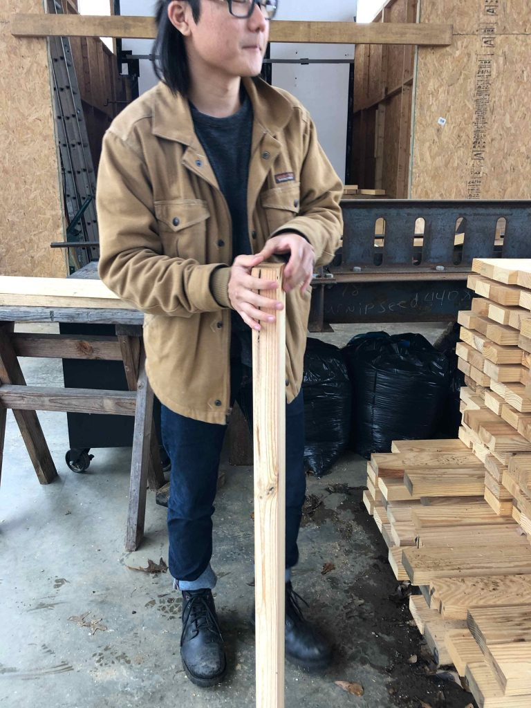 Jeff holding a 2x4