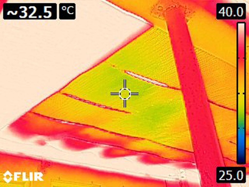 Thermal camera image of radiant barrier on carport ceiling registering at 32.5 °C.