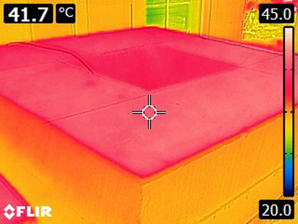 Thermal camera image of the top of concrete chimney before radiant barrier installed. Temperature registering at 41.7 °C.