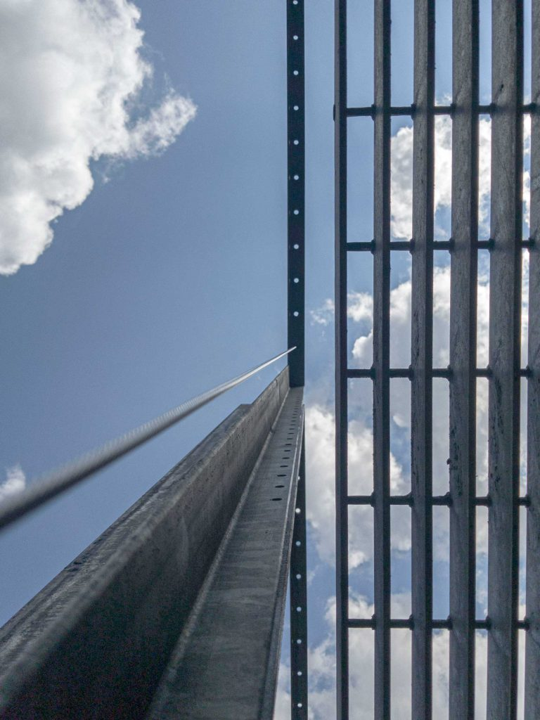 View up the tall screens and through the grate