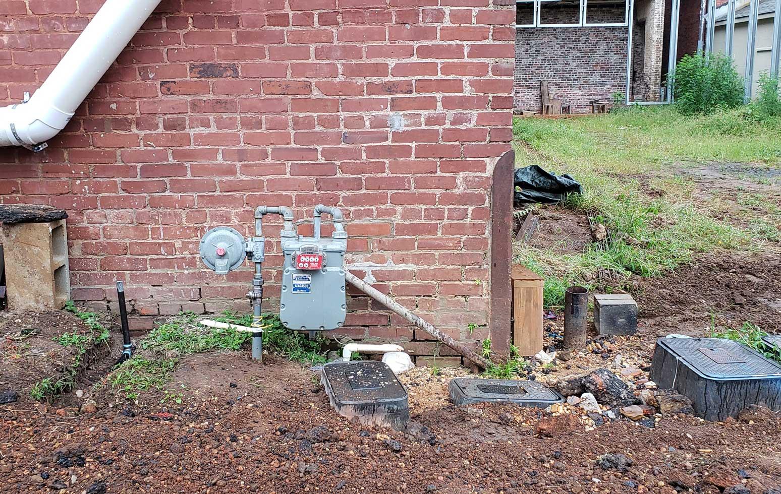 gas meter agast brick wall