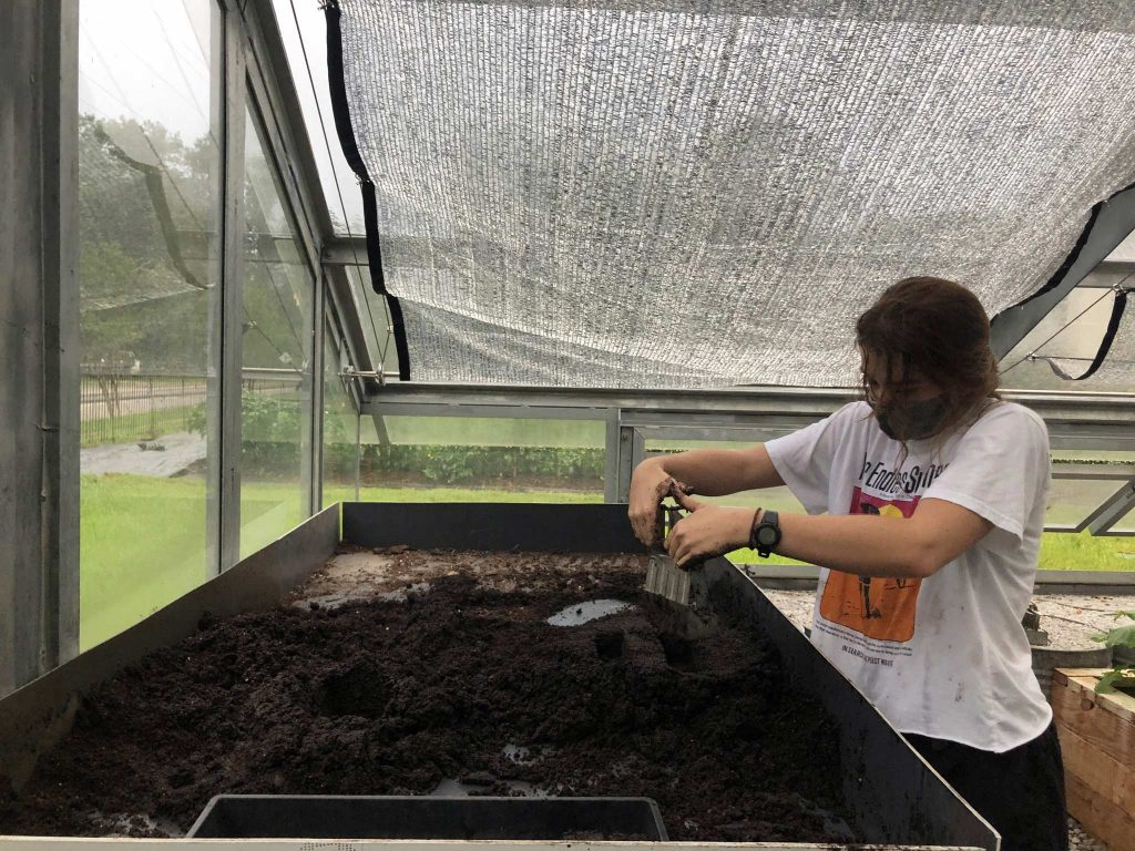 A student makes soil blocks for seed starting
