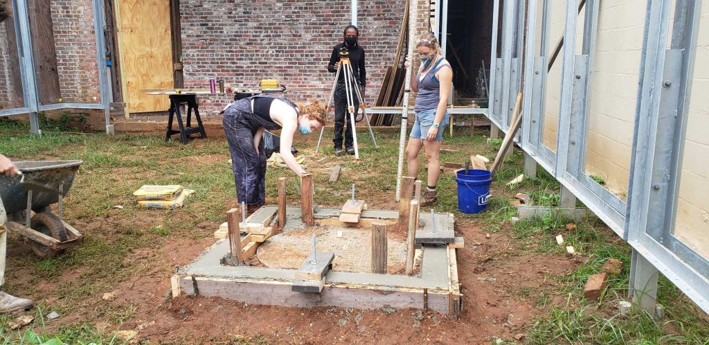 Students adjusting the level of the concrete