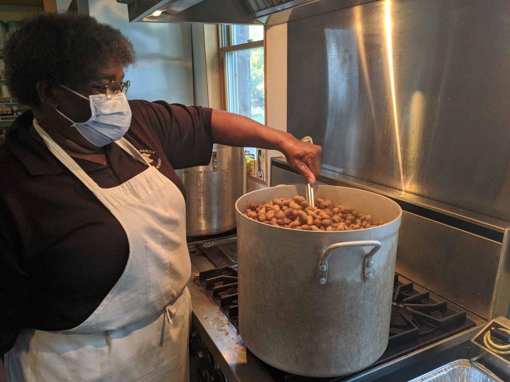 Rural Studio's cook, Cat, boils a large pot of peanuts