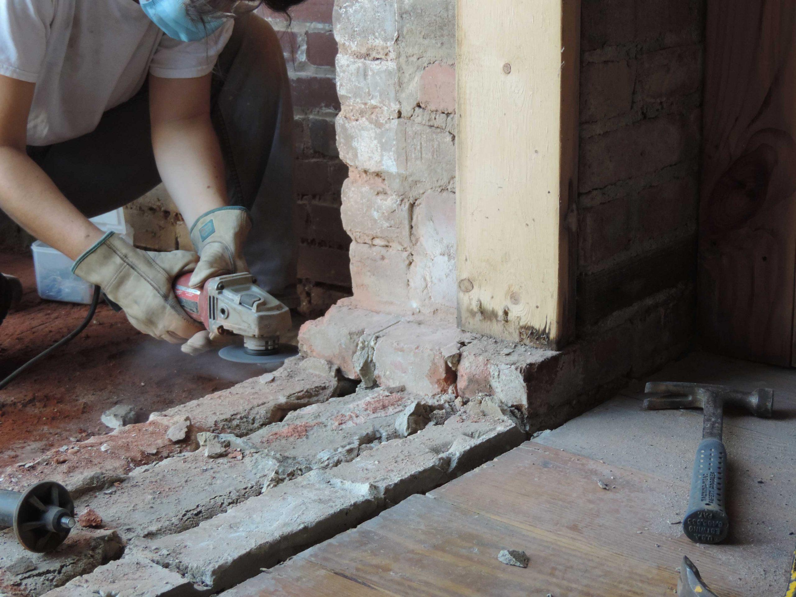 Removing bricks on door threshold