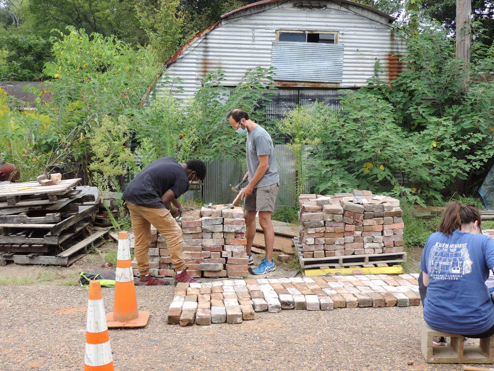Dr.Dprsey and PHF fellows cleanign bricks