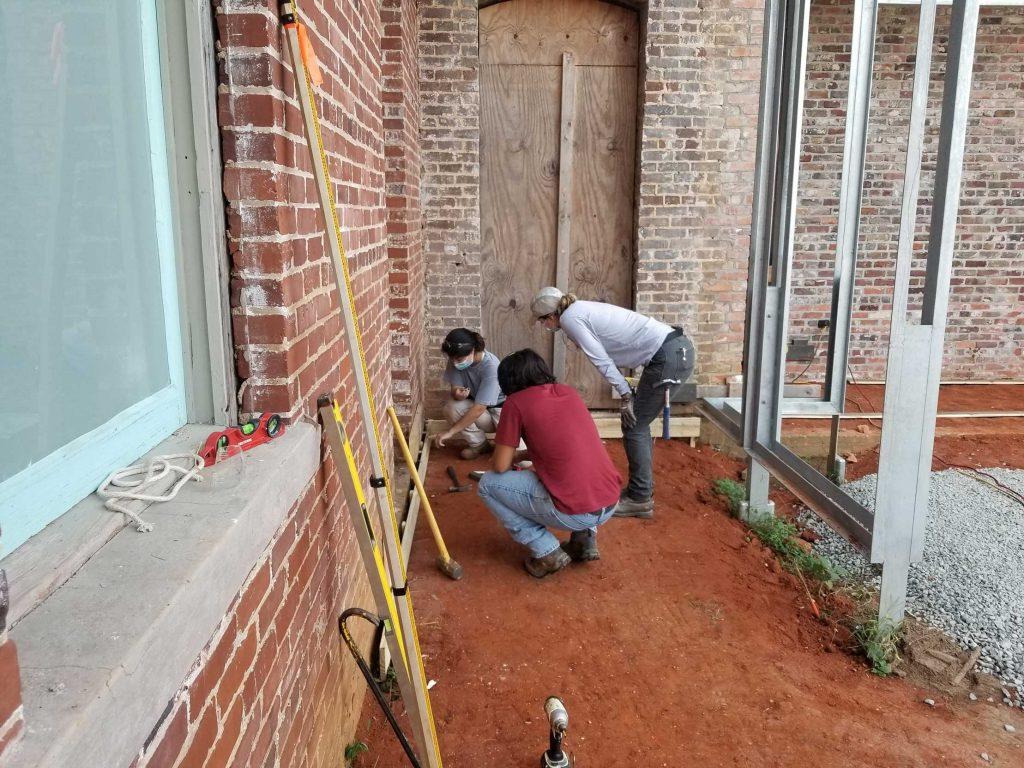 Students starting formwork under walkway