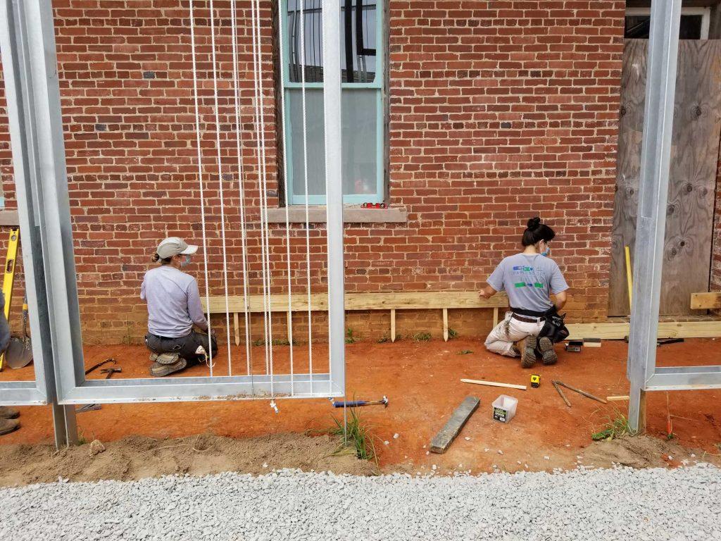 Students making formwork for concrete sidewalk