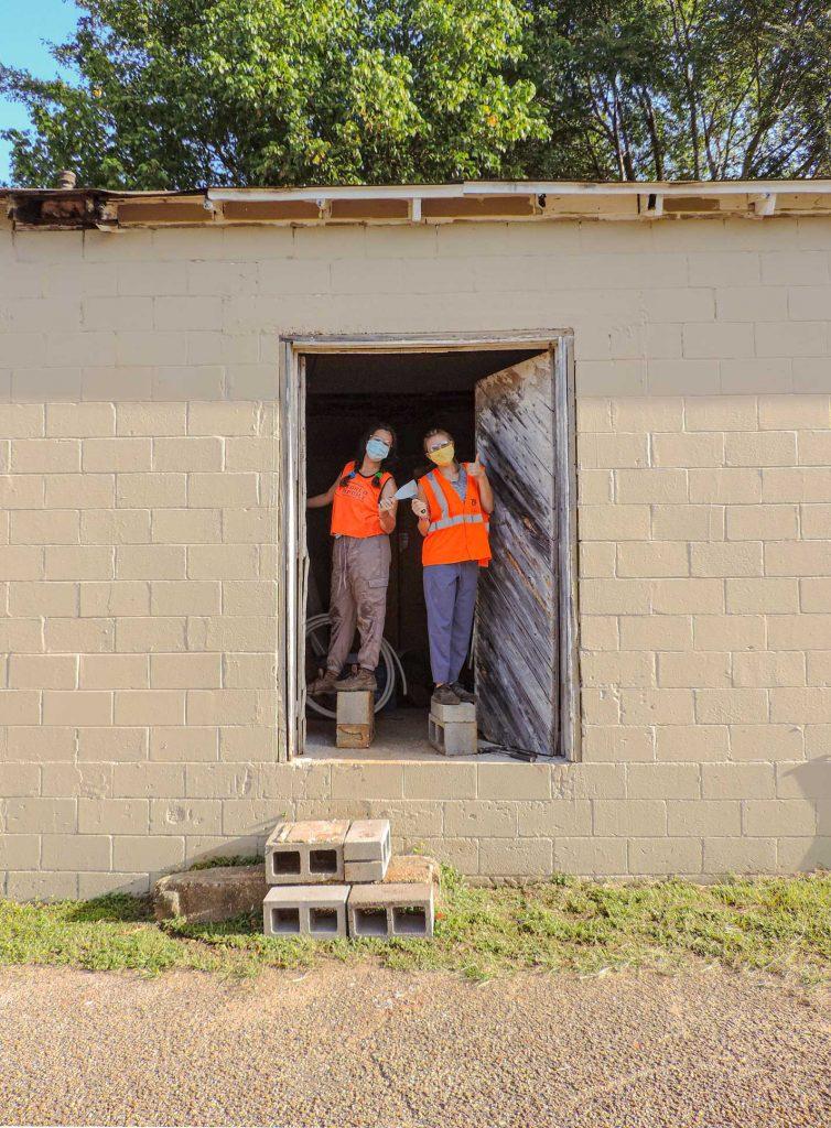 Students painting wooden door