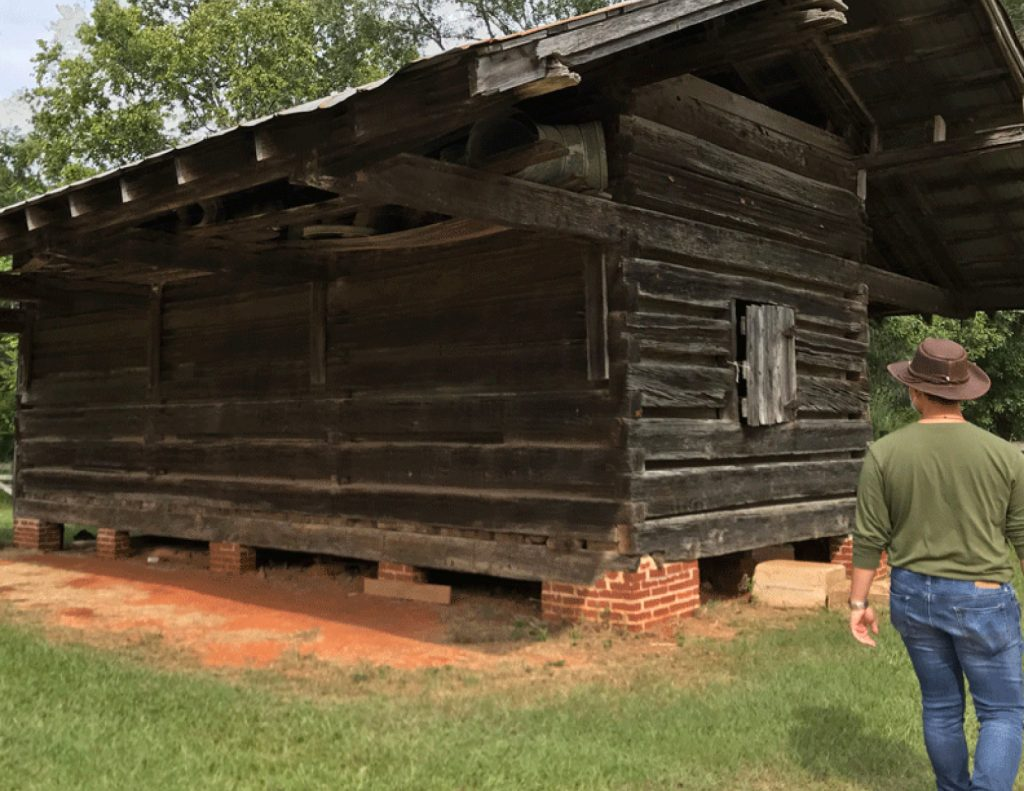 student looks at old seed house