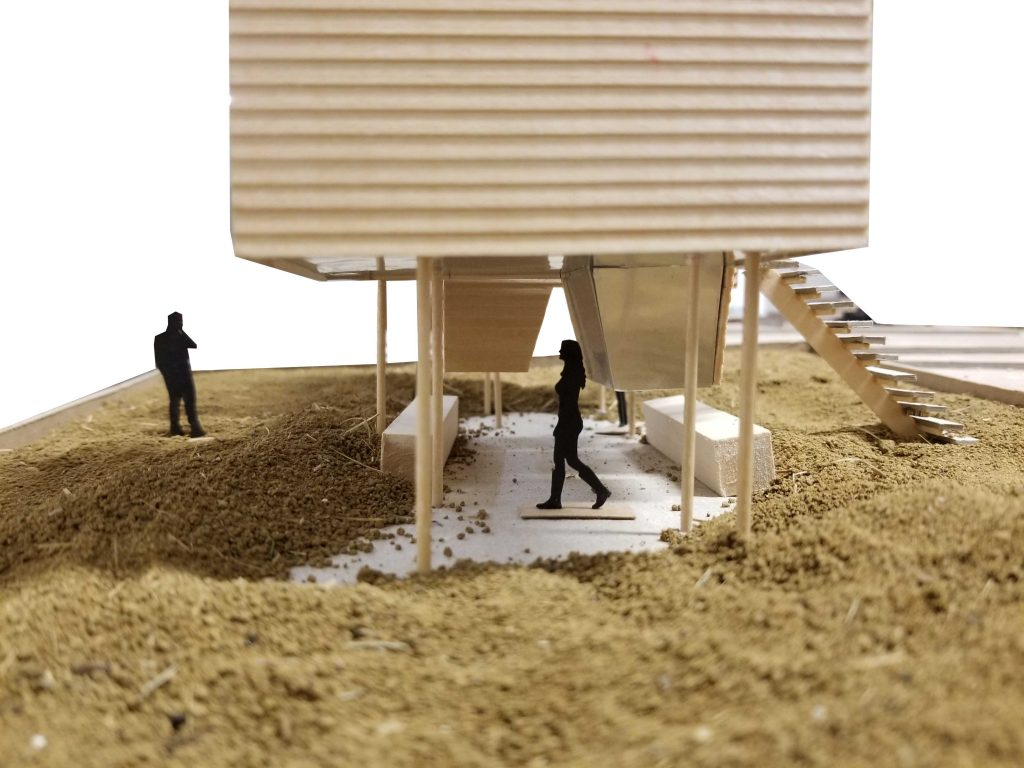 """iteration 2 1/4""""=1"""" model of pods showing scale figure in cooling patio"""