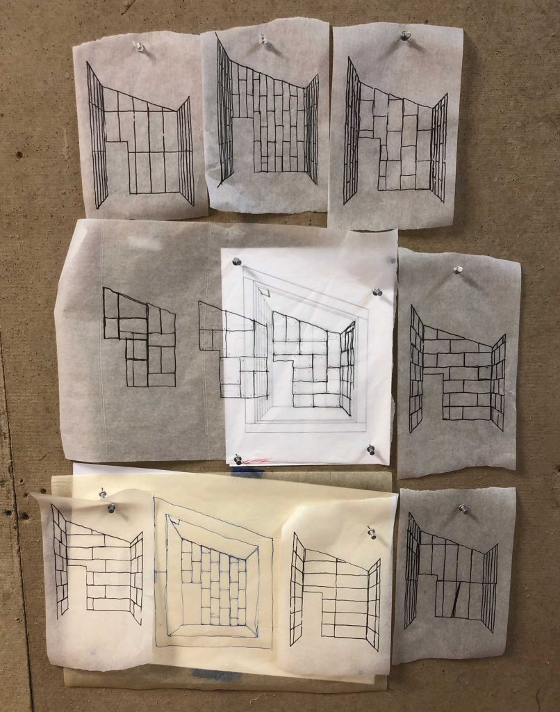 several sketches of concrete pod interior wall testing different concrete wall panel arrangements and patterns