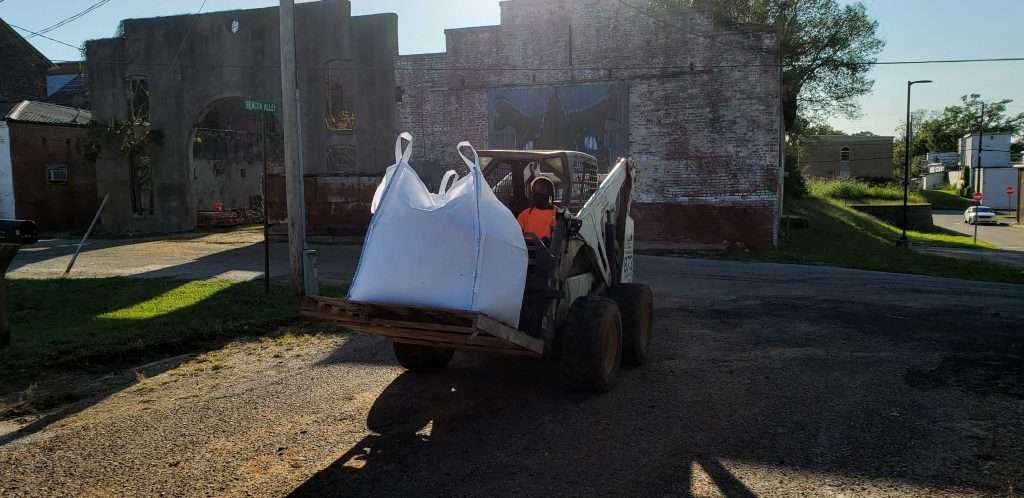 Student driving bobcat with slate Super Sack