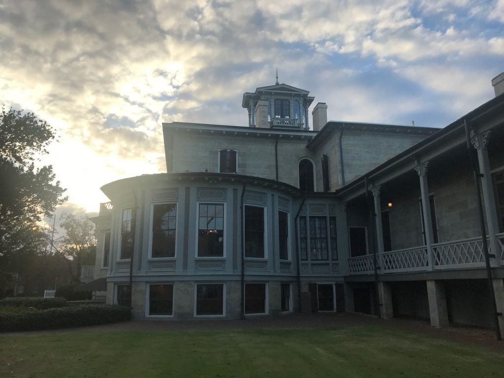 sunlight peaks out from behind Jemison Mansion