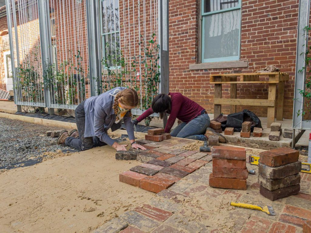 Students laying brick