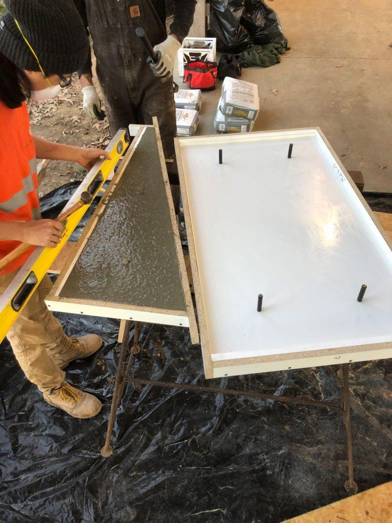 students checks level of concrete formwork